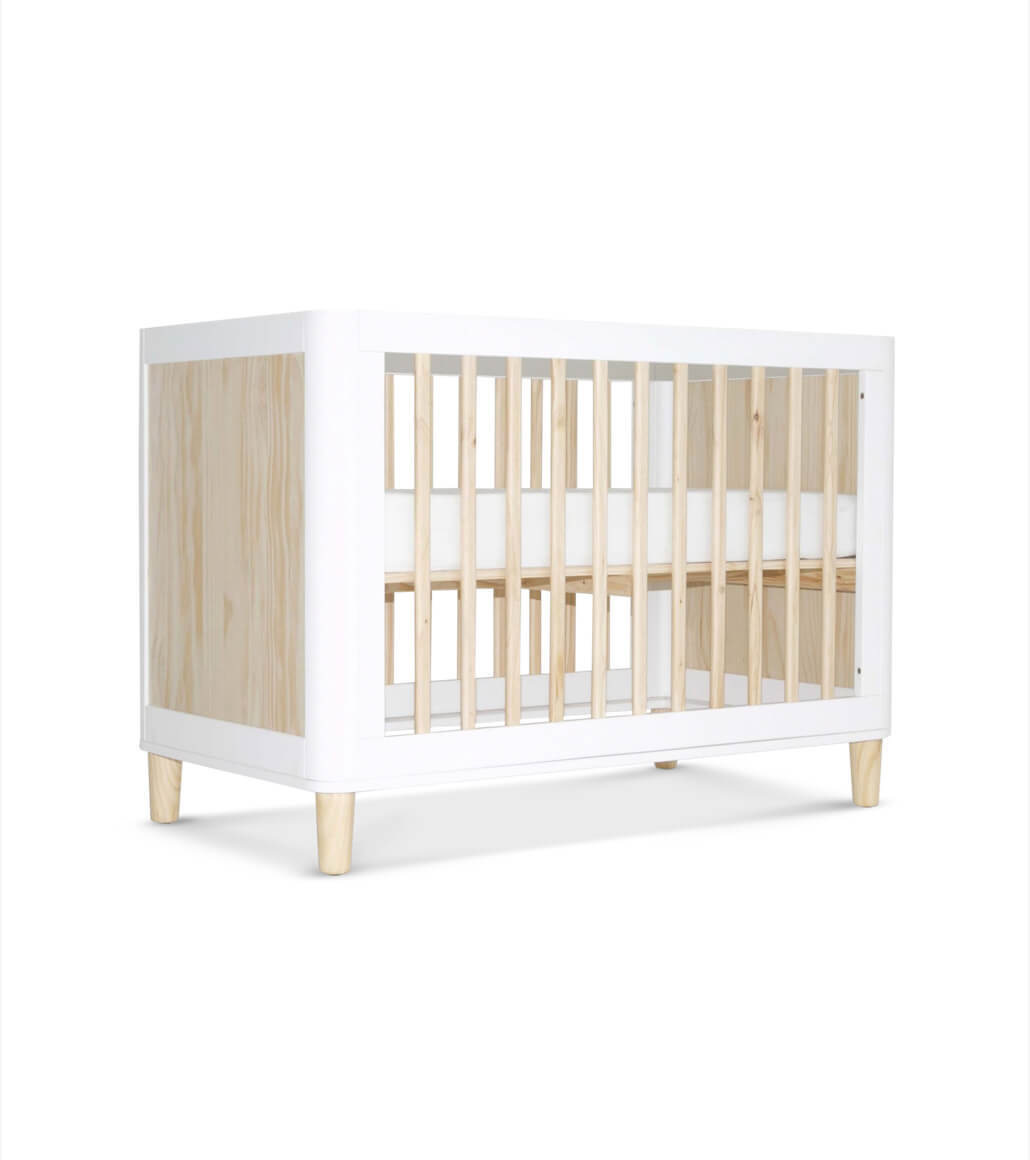 Classic wooden cot with white edges